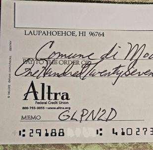 L'assegno inviato dal cittadino americano alla Polizia Municipale di Modena