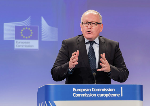 The First Vice-President of the European Commission Frans Timmermans addresses the media at the European Commission headquarters in Brussels, Wednesday, Nov. 19, 2014.