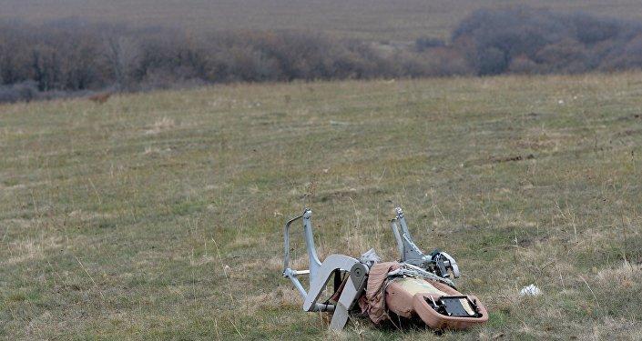 Un sedile del Boeing MH17 sul luogo dello schianto, a Shaktyorsk