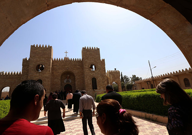 Iraqi Christians head to the Saint Joseph church in Arbil, the capital of the autonomous Kurdish region, on August 6, 2015