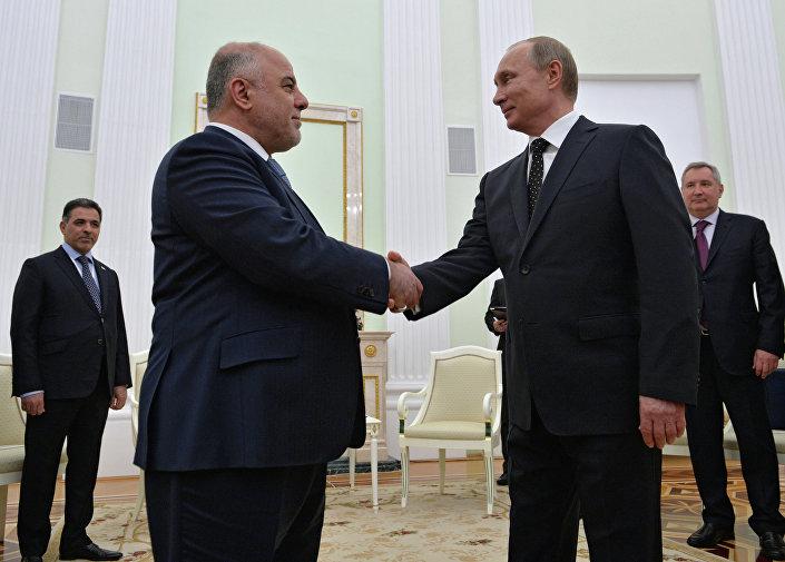 Il presidente russo Vladimir Putin incontra il primo ministro iracheno Haider Al-Abadi