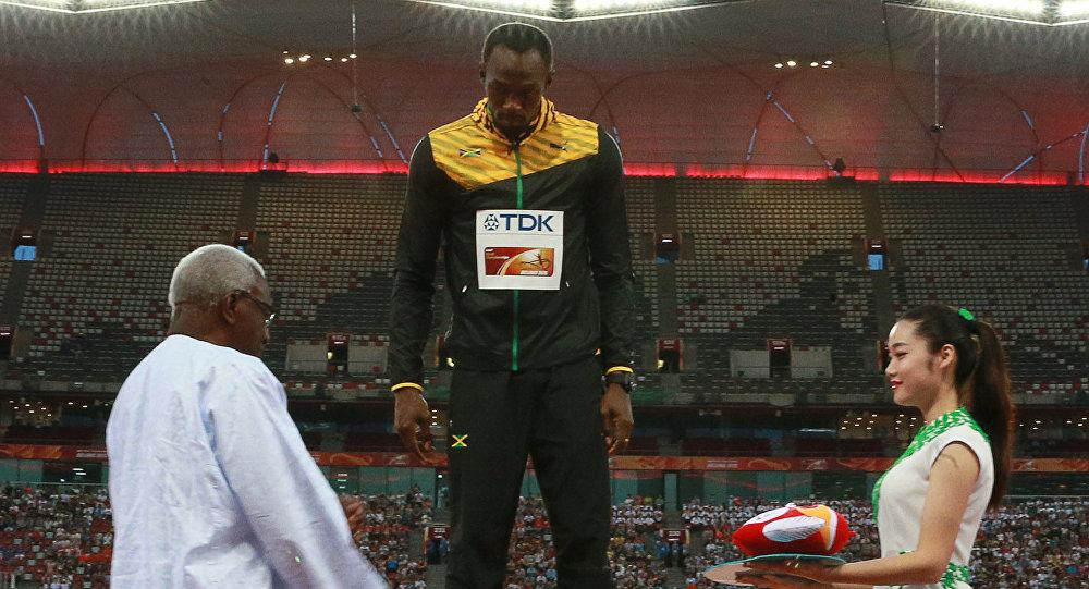 Lamine Diack premia Husain Bolt ai Mondiali di Pechino del 2015