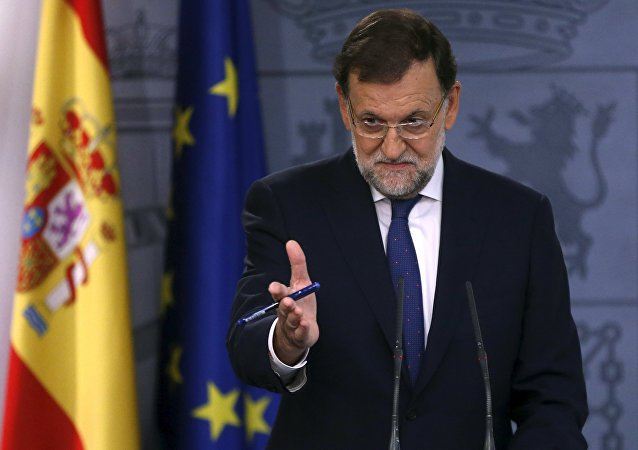 Spain's Prime Minister Mariano Rajoy gestures during a news conference at Moncloa Palace in Madrid, Spain