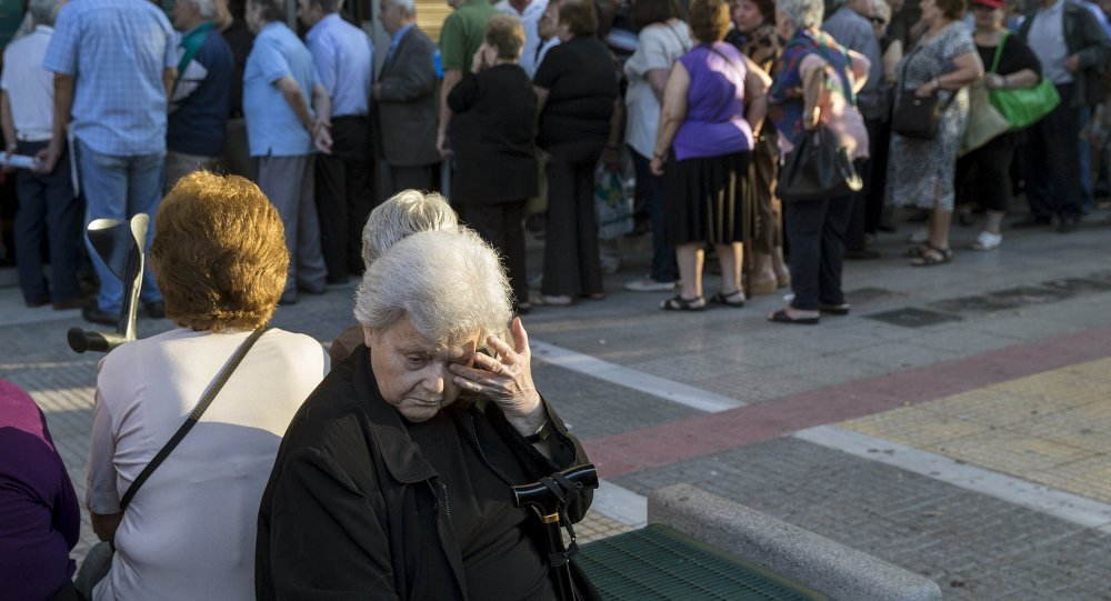 People queue to receive their pensions in front of a National Bank in Athens, Greece, July 2, 2015