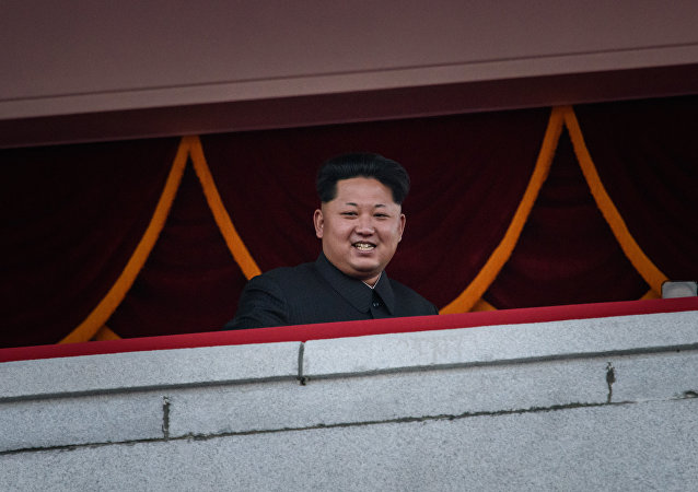 North Korea's leader Kim Jong-Un looks out towards Kim Il-Sung square during a mass military parade in Pyongyang on October 10, 2015
