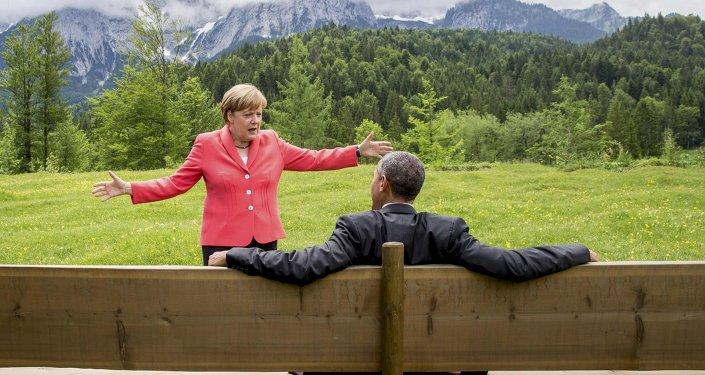 German Chancellor Angela Merkel speaks with U.S. President Barack Obama outside the Elmau castle in Kruen near Garmisch-Partenkirchen, Germany, June 8, 2015.