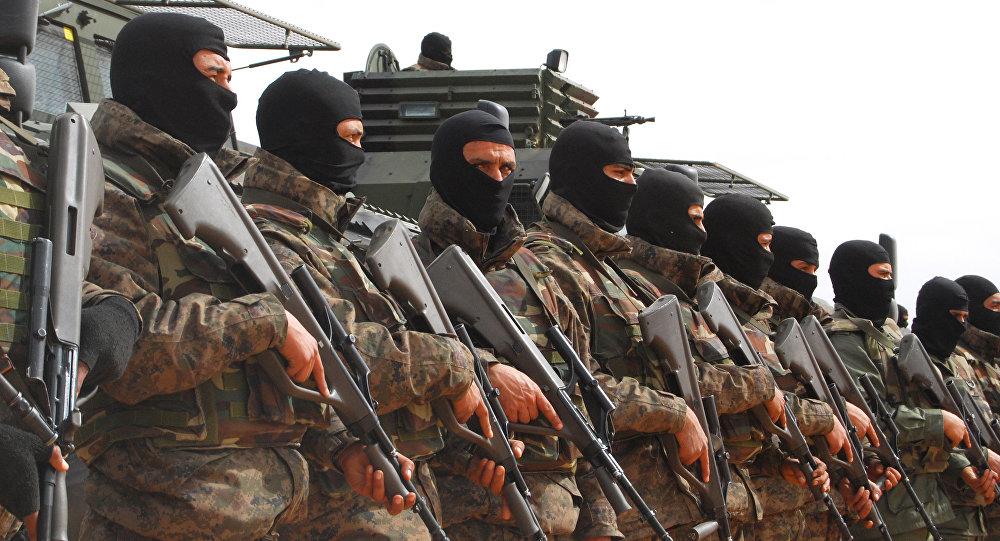 Tunisian soldiers pose during a presentation of the anti-jihadi fence, in near Ben Guerdane, eastern Tunisia.