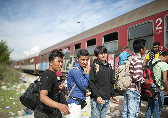 Migrants and refugees board a train, after crossing the Greek-Macedonian border, near Gevgelija on October 5, 2015.