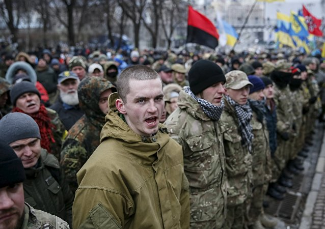 Members of self-defence battalions take part in a rally to commemorate demonstrators who were killed during the Maidan protests in 2014 in Kiev, Ukraine, February 20, 2016