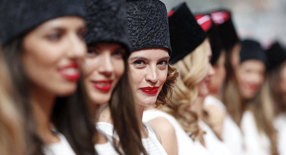 Grid girls line up for the drivers' parade before the Russian F1 Grand Prix in Sochi, Russia, October 11, 2015