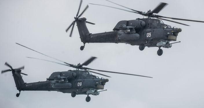 Elicotteri Mi-28 in volo.