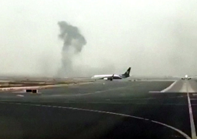 Smoke rising after an Emirates flight crash landed at Dubai International Airport