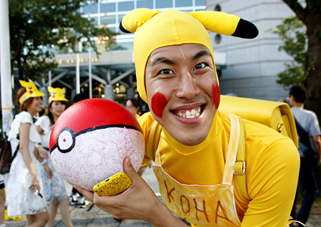 A man wearing Pokemon's character Pikachu costume poses to a camera prior to a parade by performers wearing Pikachu costumes in Yokohama