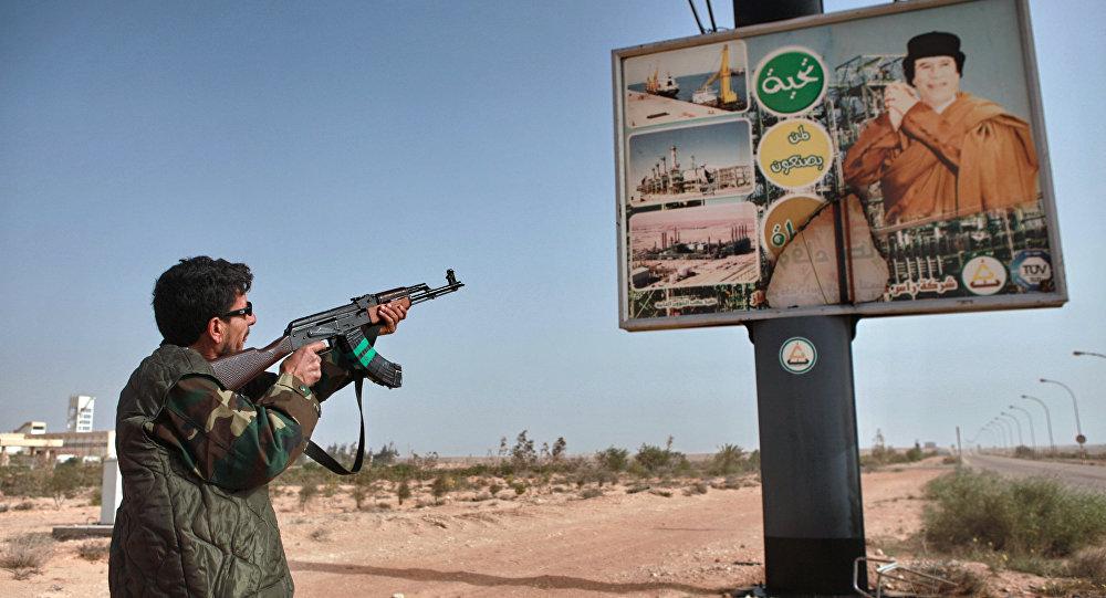 Poster con l'immagine di Gheddafi