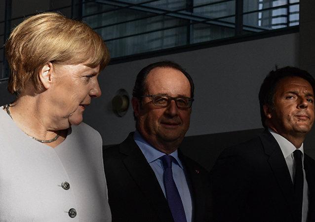 Angela Merkel, Francois Hollande e Matteo Renzi a Berlino