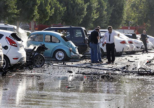 Officials investigate the site after an explosion in Turkey's Mediterranean resort of Antalya, Turkey, Tuesday, Oct. 25, 2016