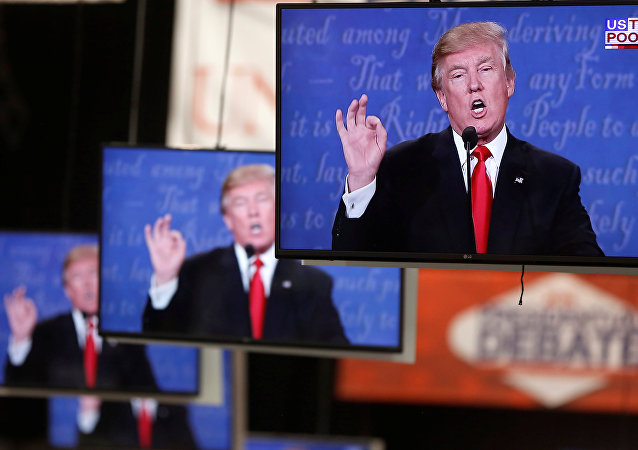 Donald Trump is shown on TV monitors in the media filing room on the campus of University of Nevada, Las Vegas, during the last 2016 U.S. presidential debate in Las Vegas, US, October 19, 2016.