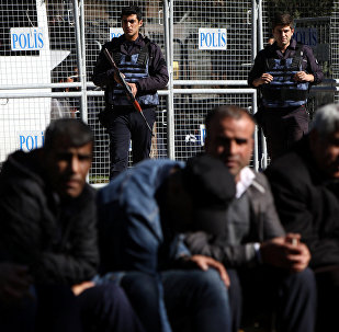 Riot police stand guard in front of a courthouse during a gathering to protest against the arrest of pro-Kurdish Peoples' Democratic Party (HDP) lawmakers, in the southeastern city of Diyarbakir, Turkey