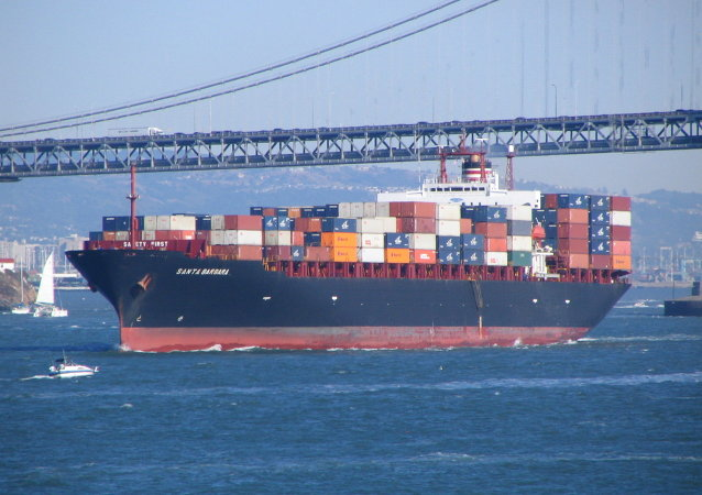 A container ship leaves the bay area.