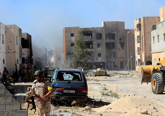 Fighters of Libyan forces allied with the U.N.-backed government gather at the eastern frontline of fighting with Islamic State militants, in Sirte, Libya