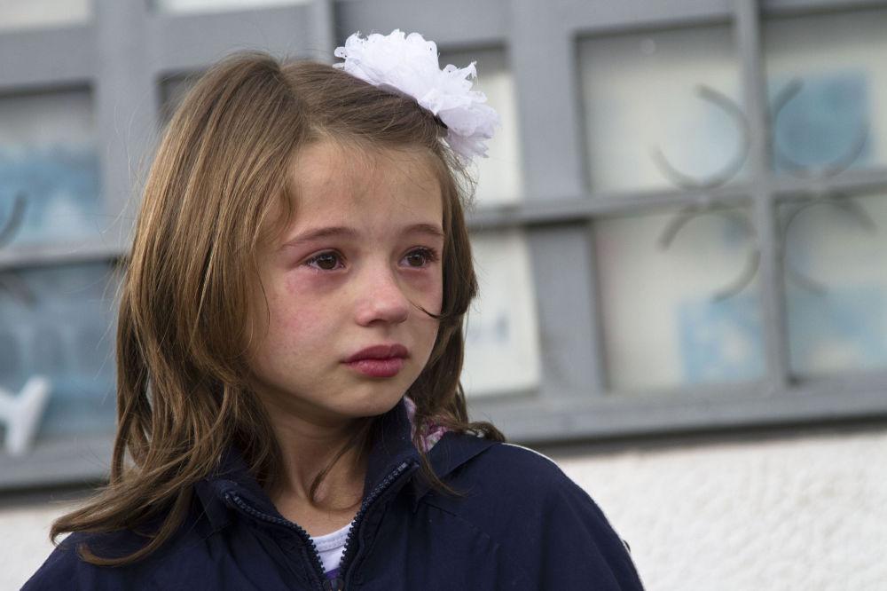 Il pianto di una bambina evacuata da Kumanovo.