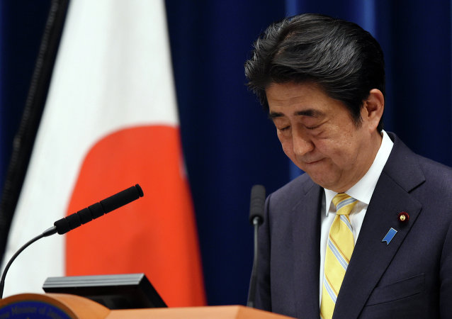 Japan's Prime Minister Shinzo Abe bows at the end of his press conference following a cabinet meeting which approved a set of bills bolstering the role and scope of the military, at his official residence in Tokyo on May 14, 2015