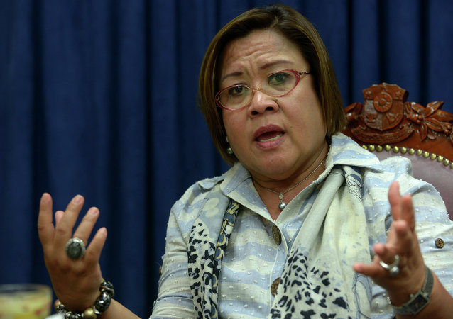 Philippine Justice Secretary Leila de Lima gesturing during an interview with AFP in Manila