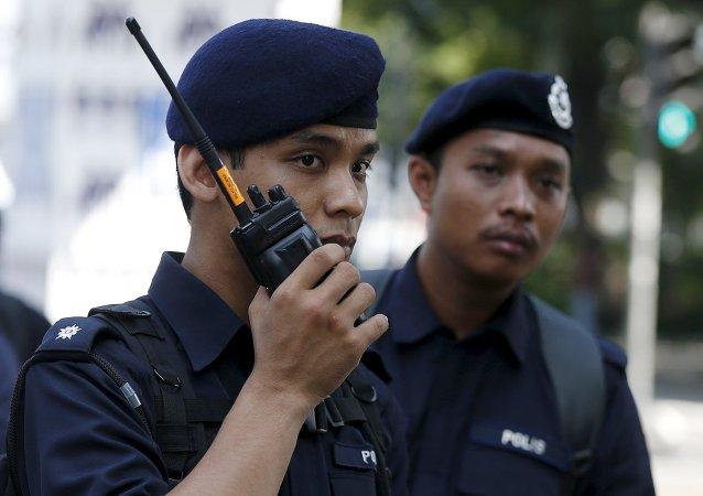 Poliziotti malesi