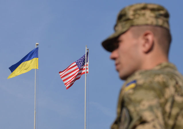 An Ukrainian serviceman stands in front of US and Ukrainian flags during the opening ceremony of the Rapid Trident military exercises on September 15, 2014 near the western Ukrainian town of Yavoriv. US-led military exercises began in Ukraine on Monday after a day of deadly fighting between government forces and pro-Russian rebels in the restive east that has piled pressure on a shaky 10-day-old truce.