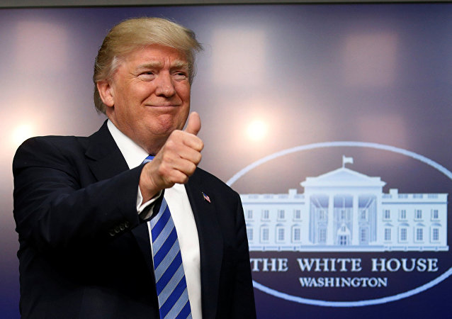 U.S. President Donald Trump gives a thumbs up as he hosts a CEO town hall on the American business climate at the Eisenhower Executive Office Building in Washington, U.S., April 4, 2017