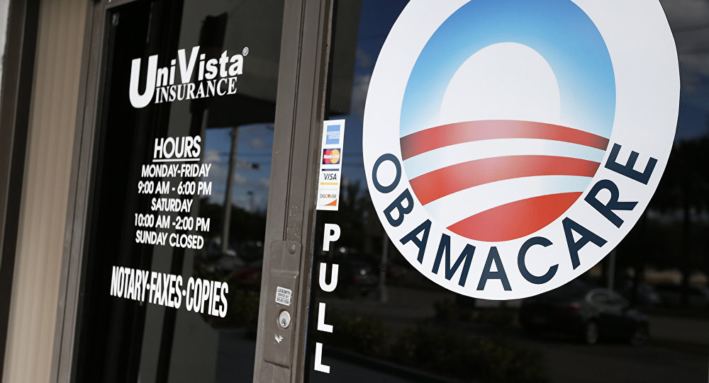 An Obamacare logo is shown on the door of the UniVista Insurance agency in Miami, Florida on January 10, 2017
