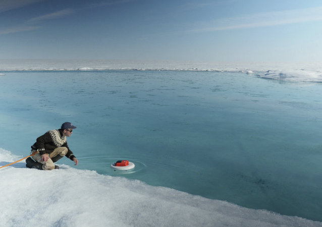 Laurence C. Smith, Chair of Geography at University of California, Los Angeles, deployed an autonomous drifter in a meltwater river on the surface of the Greenland ice sheet on July 19, 2015. The floating instrument was quickly swept away by the fast-moving glacial waters and ultimately swallowed by a moulin, a sinkhole in the ice. Although the scientists will never be able to recover the device from the depths of the ice sheet, the measurements it took and transmitted on its way down the waters will help scientists better understand how the network of streams and rivers that forms on the surface of the ice sheet when ice melts in the spring and summer contributes to sea level rise.