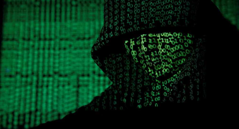 A projection of cyber code on a hooded man is pictured in this illustration picture taken on May 13, 2017