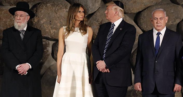 US President Donald Trump, center, first lady Melania Trump, center left, , Rabbi Israel Meir Lau, left, Israeli Prime Minister Benjamin Netanyahu are seen during a visit to the Yad Vashem Holocaust Memorial museum
