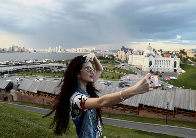 Soccer Football - FIFA Confederations Cup Russia 2017 - Kazan, Russia - 19/06/17 A woman takes a selfie at the Kremlin of Kazan.