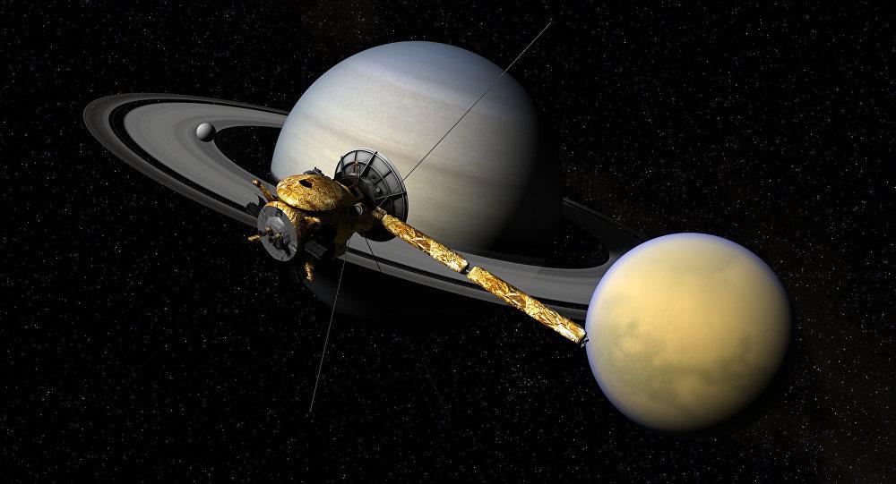 La sonda cassini con Saturno e Titano