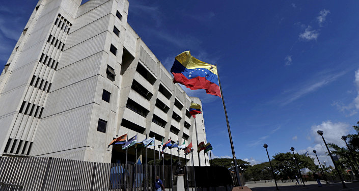 A man walks in front of a building of the Venezuela Supreme Court in Caracas December 23, 2015