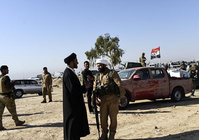 Militanti della milizia sciita irachena al-Hashd al-Shaabi