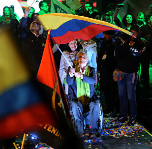 Ecuadorean presidential candidate Lenin Moreno (C) wait with supporters for the results of the national election in a hotel, in Quito, April 2, 2017