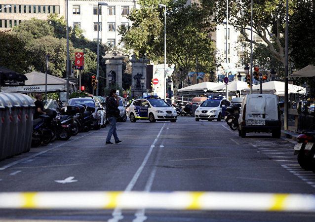 A street is cordoned off after a van crashed into pedestrians near the Las Ramblas avenue in central Barcelona, Spain August 17, 2017.