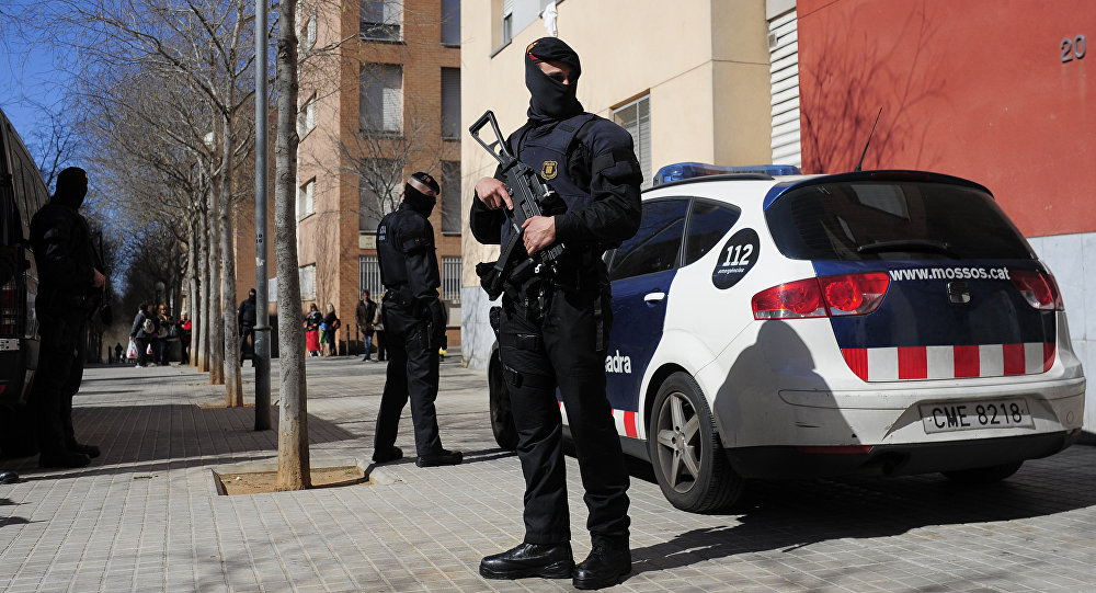 Mossos d'Esquadra regional police officers stand guard during a raid in one of the region's biggest operations against jihad activity in Sabadell, near Barcelona, Spain, Wednesday, April 8, 2015