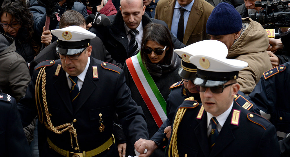 Mayor of Rome Virginia Raggi (C) leaves the city hall on the Campidoglio Square (Piazza Campidoglio) in central Rome on December 20, 2016