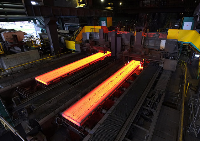 The picture shows red hot steel being flattened in the hot rolling plant at the ThyssenKrupp steel mill Hamborn pictured on December 12, 2014 in Duisburg , western Germany