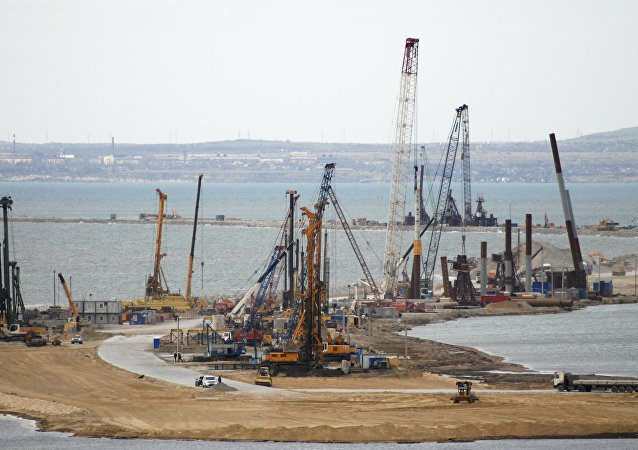 The construction of a bridge across the Kerch Strait to Crimea is seen from the outskirts of the Taman settlement in Krasnodar region, southern Russia, April 4, 2016