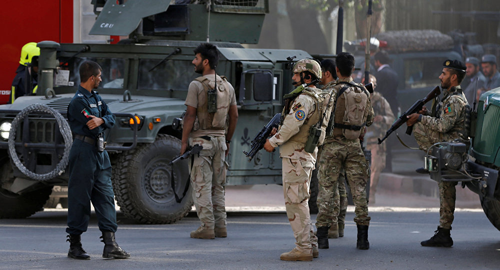 Afghan security forces leave after gunfire at the site of an attack in Kabul, Afghanistan July 31, 2017