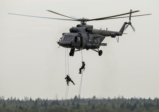 Troops land from a Mi-8AMTSh helicopter during a show at the ARMY 2015 International Military-Technical Forum held outside Moscow