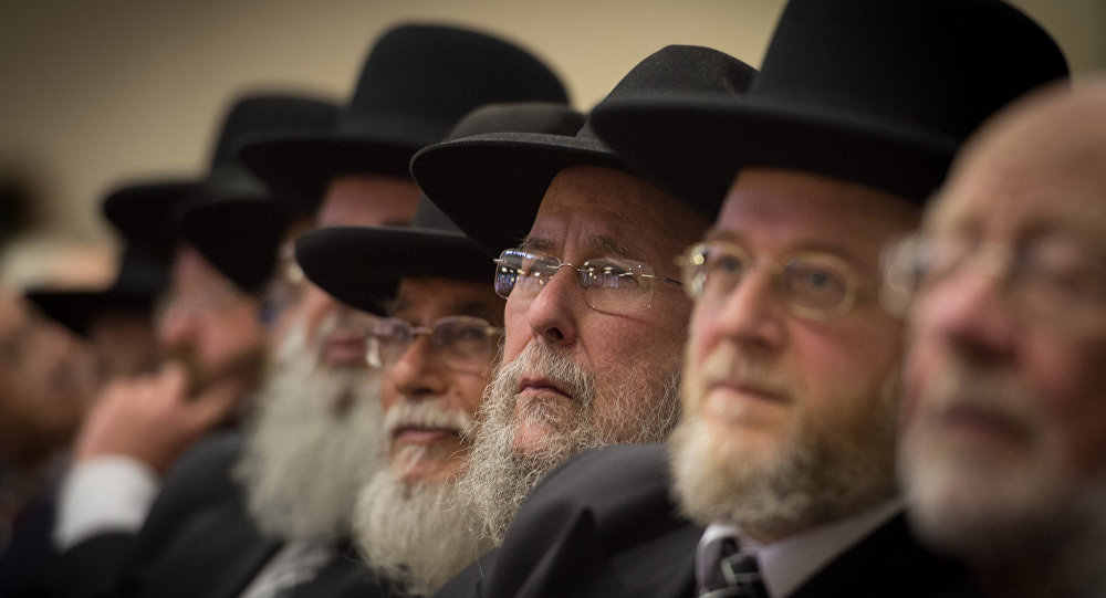 Rabbis and members of the Orthodox Jewish community attend the Installation of Chief Rabbi Ephraim Mirvis as the 11th Chief Rabbi of the United Hebrew Congregations of the UK and the Commonwealth during a ceremony at the St John's Wood Synagogue in north London on Spetember 1, 2013.