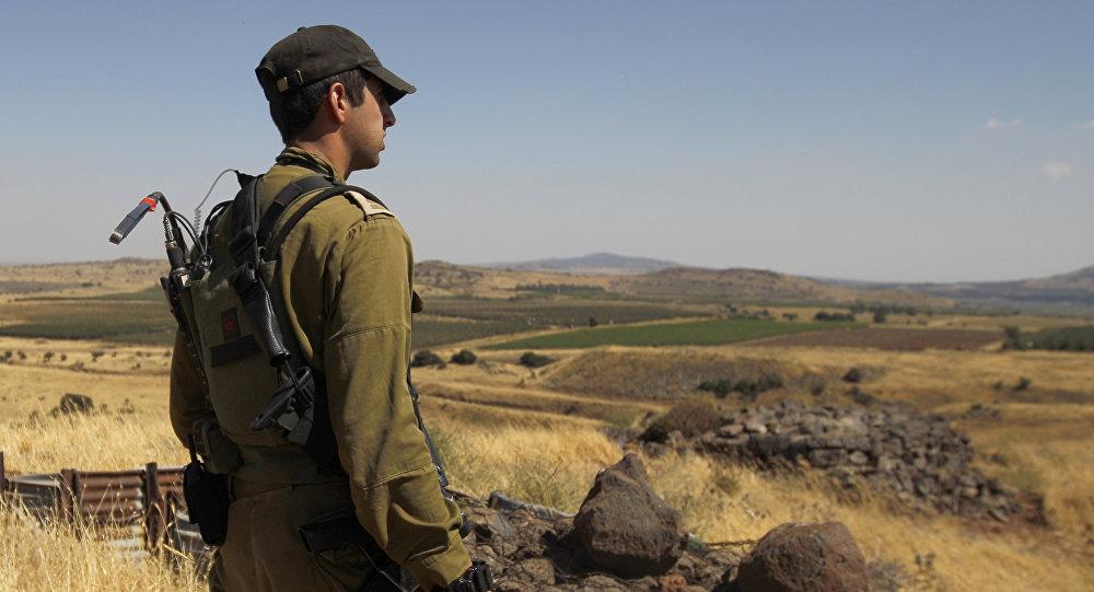 Soldato israeliano al confine con la Siria
