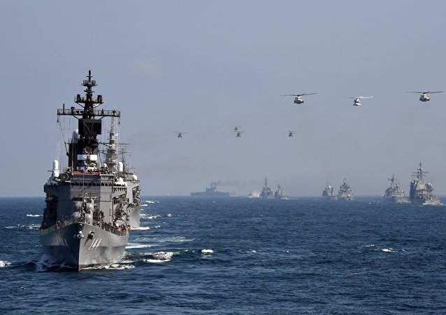 Japan's Maritime Self-Defense Force (MSDF) escort ship Kurama (L) takes part in a fleet review off Sagami Bay, Kanagawa prefecture (File)