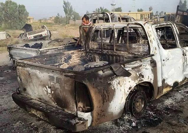 Veicolo distrutto dopo raid della coalizione USA in Iraq